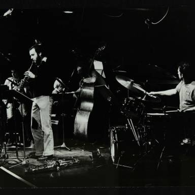 John Etheridge, Phil Todd, Michael Garrick, Jeff Clyne and Harold Fisher (left to right)