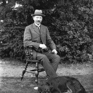 G36-242-09 Seated man with dog at feet.jpg
