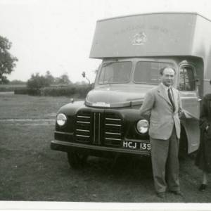 Cyril Jenkins and customer in front of Black Mountains (H1) mobile library van, c.1960s