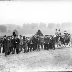 G36-065-03 Approx 30 men ready to pull carriage with Paul Foley and bride seated inside.jpg