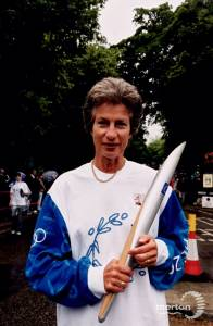 Virginia Wade carrying the Olympic torch through Merton