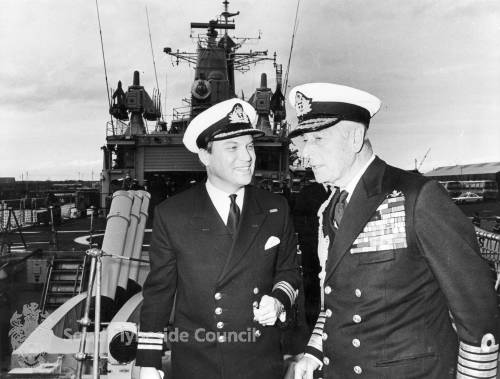 Admiral of the Fleet, Earl Mountbatten of Burma and an unidentified Lt. Commander.
