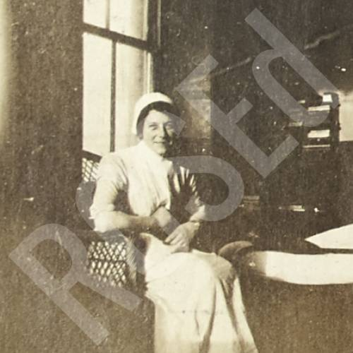 Nurse E.M.W. Sitting in Chair in Ward Z6
