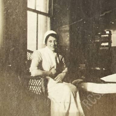 Nurse E.M.W. Sitting in Chair in Ward Z6