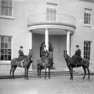G36-220-10 Three ladies posing on horseback in front of The Weir [same as G36-220-05].jpg