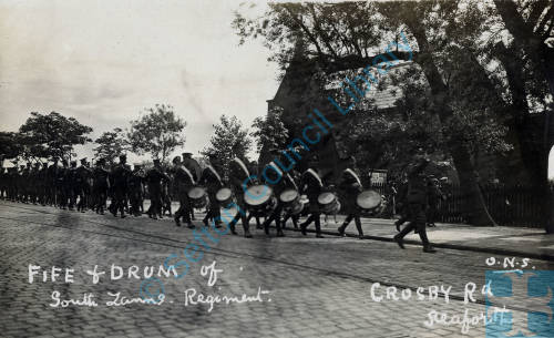 South Lancashire Regiment marching along Crosby Road with fife and drums playing, 1914