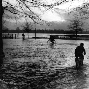 Cycling through floods at Bishops Meadows Hereford.