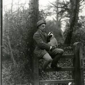 G36-194-01 Man sitting on gate holding badger.jpg