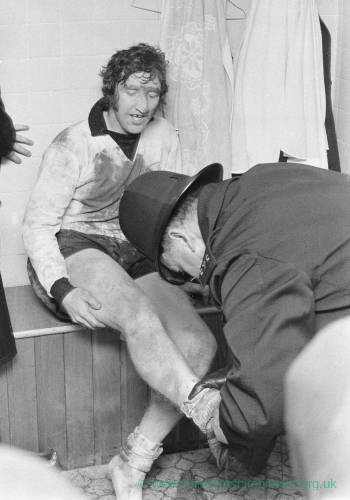 PC Roy Short removes Billy Meadow's boots after the FA Cup match