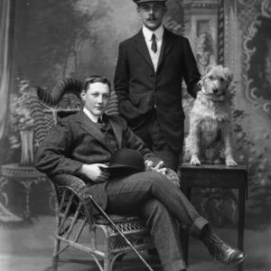G36-299-03 Portrait of two men with dog, one standing one seated.jpg