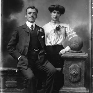 G36-060-01 Portrait of man and lady, both wearing flowers in buttonholes.jpg