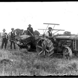 G36-396-02 Group of farm workers around Fordson tractor and harvesting machine.jpg