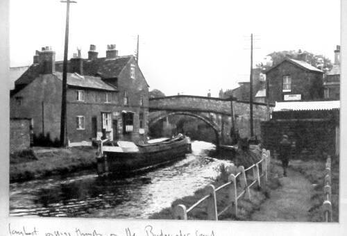 Lymm Bridge with narrowboat