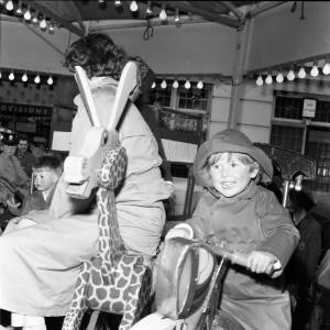 A young child enjoying a ride at the May Fair Hereford, 1965.