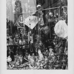 692 - Looking into a shop window in Belgium filled with curios