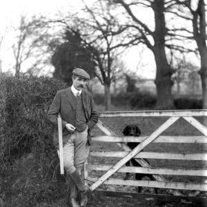 G36-324-08 Father [as G36-324-01] holding a shotgun, with dog.jpg