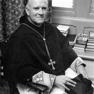 A bishop posing for a photograph.