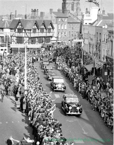 A procession of cars travelling through High Town, Hereford.