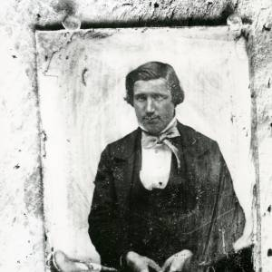G36-007-12 Copy of old photograph of man with loose bow tie.jpg