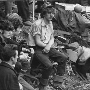 359 - Five despondent looking men sitting on rubble and slurry - The Aberfan disaster
