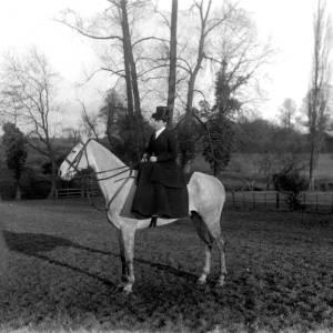 G36-320-09 Lady seated side saddle on grey hunter horse.jpg