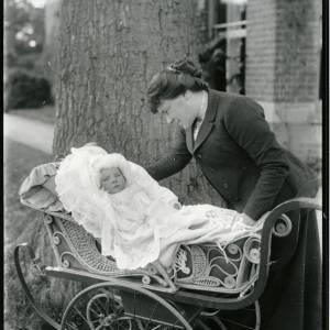 G36-022-05 Lady looking at baby in ornate pram.jpg