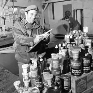 SAS Trooper McClean checking supplies.