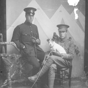 Two soldiers with King's Shropshire Light Infantry badges and dog