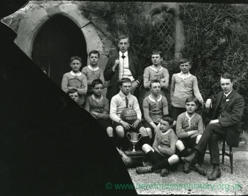 G36-205-05 Blue Coat School football team 1910-1911 & 2 masters.jpg