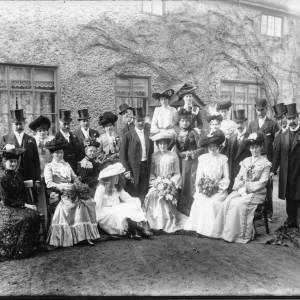 G36-038-01 Wedding group. Nine men, fourteen ladies one a young girl in garden in front of house.jpg