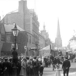 May fair in Broad Street, Hereford, crowds around a bear in forefront, c.1900