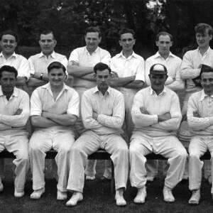 Unknown cricket team plus officials.