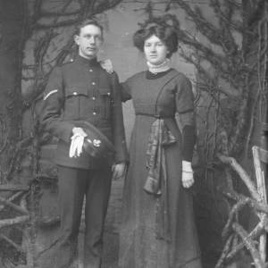 Soldier in uniform stood with lady