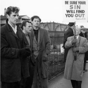 Group of men at a demonstration.