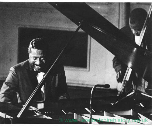 243 - Two black musicians; one playing piano (Errol Garner) and the other double bass