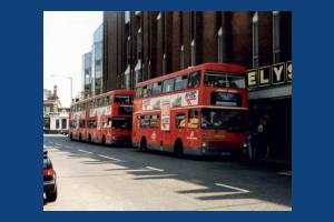 All England Lawn Tennis Club Shuttle Buses, pictured in front of Ely's Department store, Wimbledon