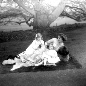G36-322-05 Lady with two little girls and a dog on a lawn.jpg