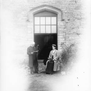 G36-075-13 Revd. Hyatt Warner next to his wife Grace Eliza outside the Old Vicarage at Almeley .jpg