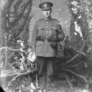Soldier in uniform, with gloves and swagger stick
