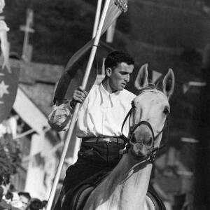 005 - Man carrying banner on horseback