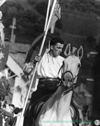 005 - Man carrying banner on horseback
