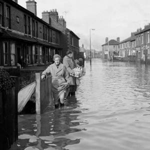 Delivering milk to a flooded Edgar Street