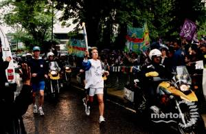 Virginia Wade carrying the Olympic torch through Merton.