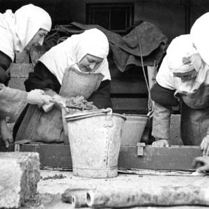 Nuns engaged in construction work