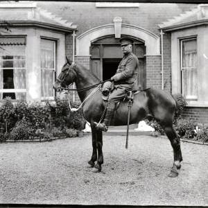 G36-253-01 Officer on horseback outside a large double-fronted house .jpg