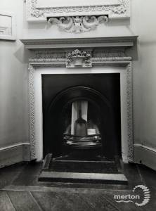 Fireplace in a first floor bathroom, Morden  Hall, Morden