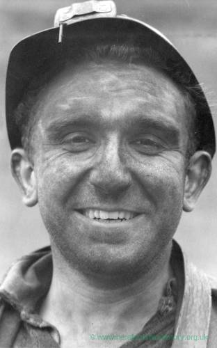 Portrait of smiling miner; close up