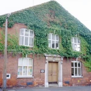 Building covered in foliage, Hereford, c1990