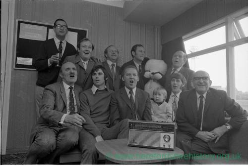 Hereford United players and directors listening to the FA Cup draw, 1972.