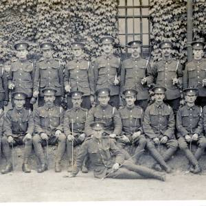 Line up of soldiers, undated postcard